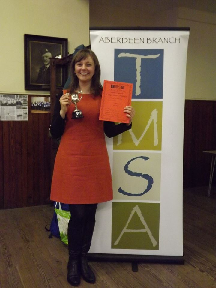 22nd March 2016    TMSA SONG WRITING COMPETITION   On 19th March 2016 I submitted a couple of entries to the  Traditional Music & Song Association of Scotland  (TMSA) annual song writing competition. Arrival at the Boys Brigade Headquarters on Crimon Place in Aberdeen on Saturday afternoon brought the usual convivial conversations with old musical friends over a rowie and a cuppie tea. I'd entered to meet other song writers in the lonely craftsperson's world we inhabit, and to hear fresh material as inspiration. The class attracted fourteen entries, all in the Scottish traditional style. Song themes included rabbit trapping, birdsong, sea fishing and hitchhiking, and melodies and song structures were as varied as the participants themselves. Our adjudicators were Bothy Ballad king, Hector Riddell, and Scottish Traditional Music Hall of Fame inductee, Doris Rougvie. They said they'd never seen a competition like it and needed time to consider their verdict after more than one hour of listening to entries. I'd so loved the other work I'd heard that I was frozen to the spot on learning that'Hands Across The Hills' had won first prize. A delightful surprise and fresh impetus to recommence writing on return to Shetland next month.  With thanks to the TMSA for the above photo, and for organising a fantastic day of competitions which help keep our culture alive and kicking. Weel duin!