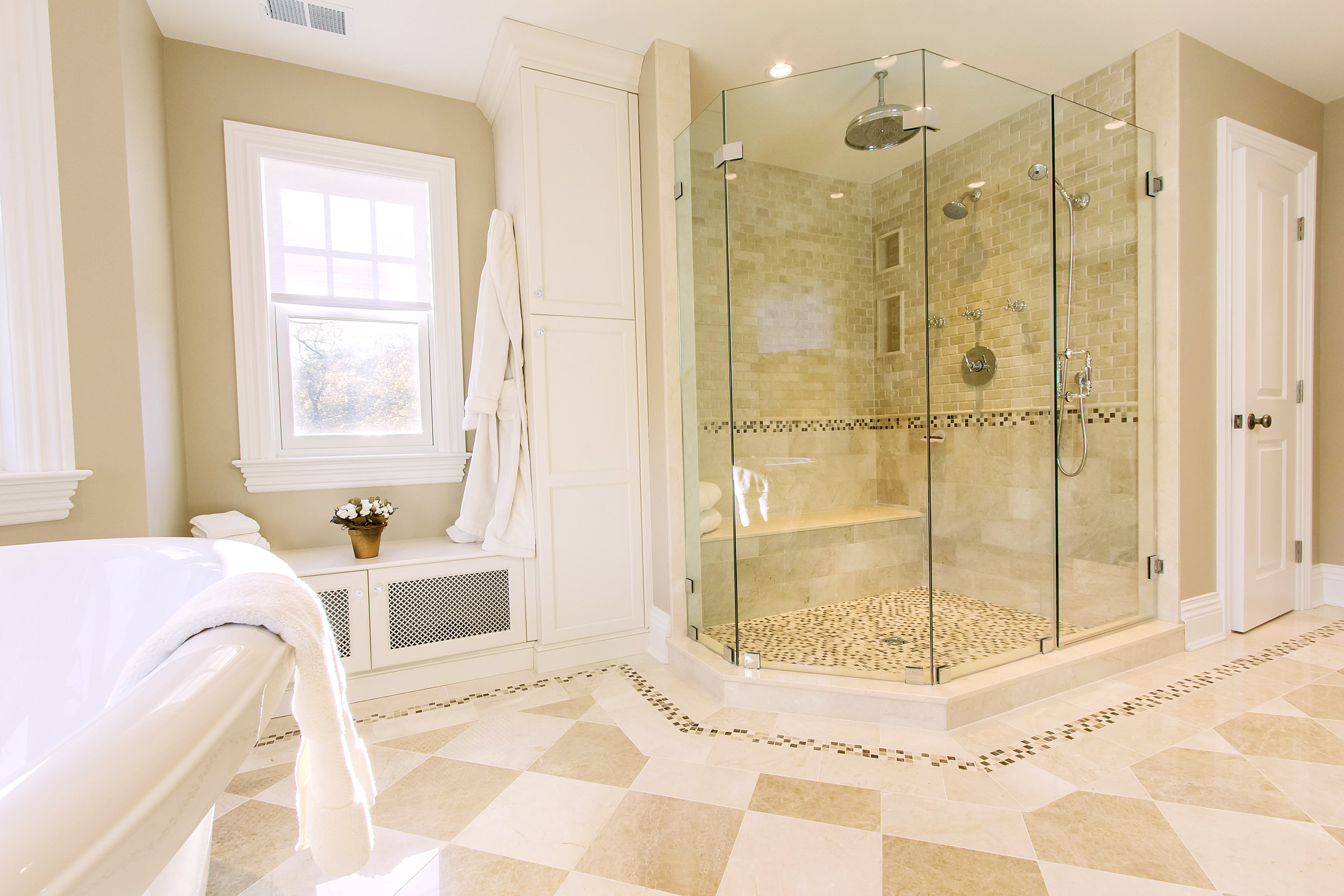 Luxurious bathroom with glass walled shower
