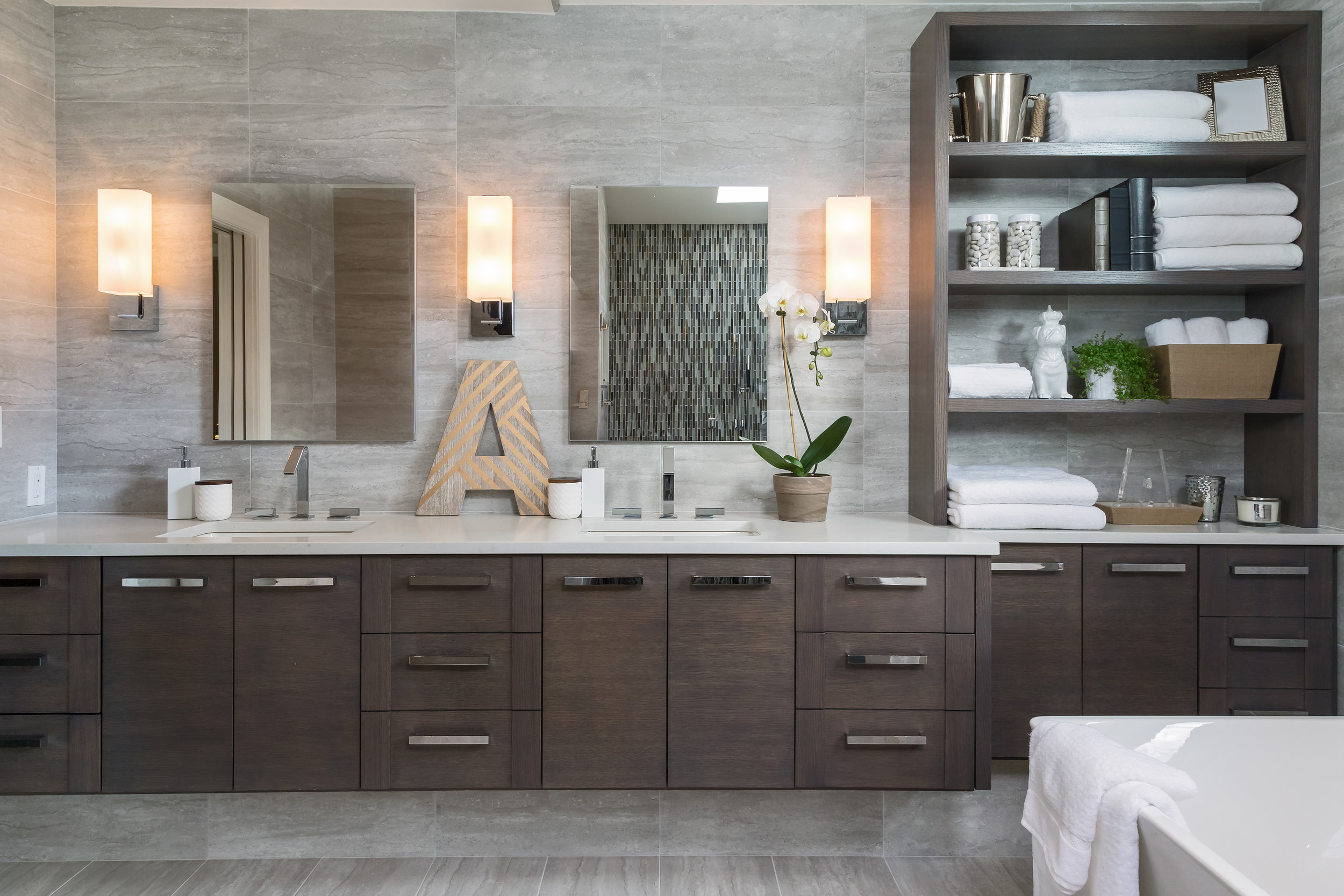 Modern bathroom with long counter with multiple sinks