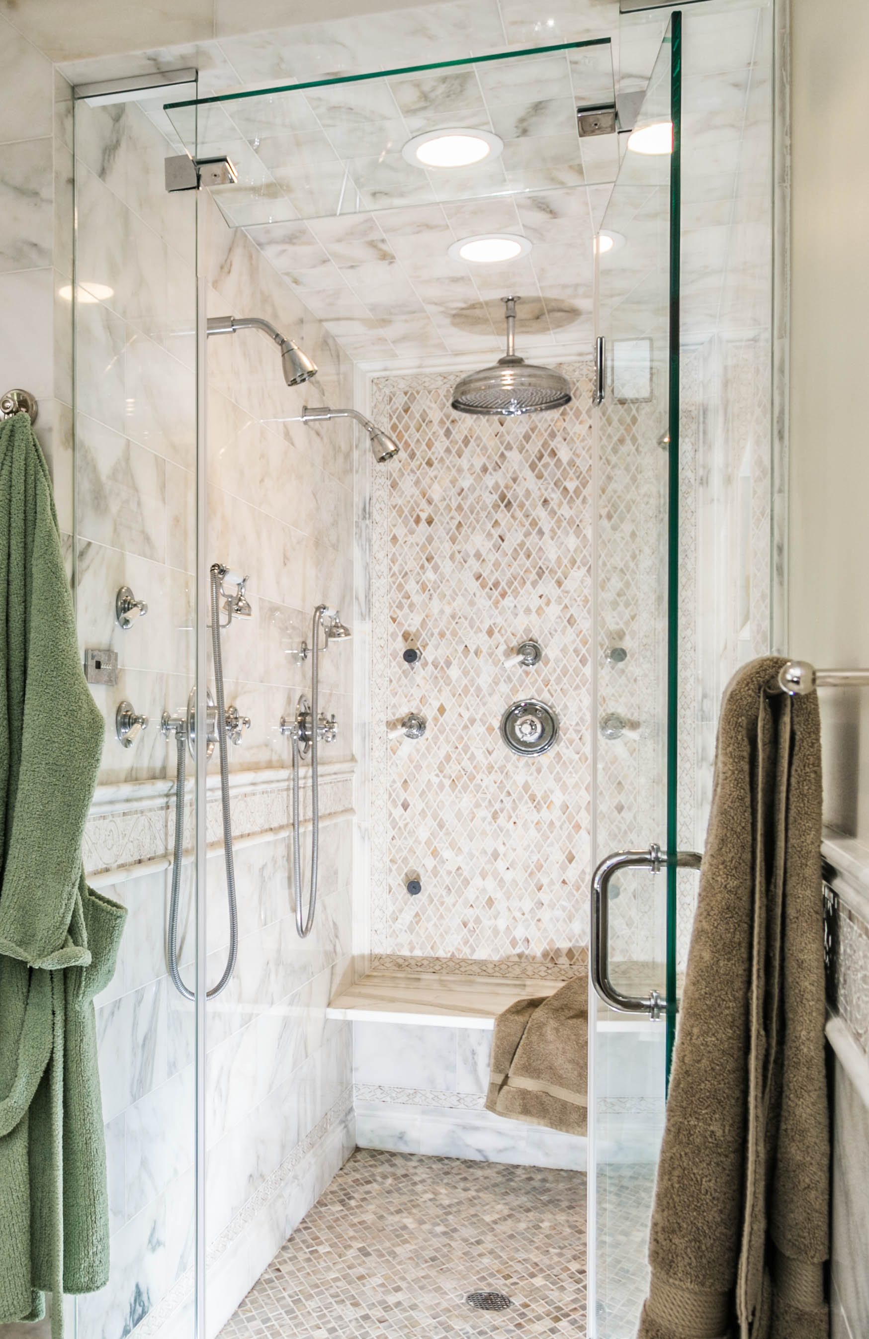Bathroom with glass walled shower and towel racks