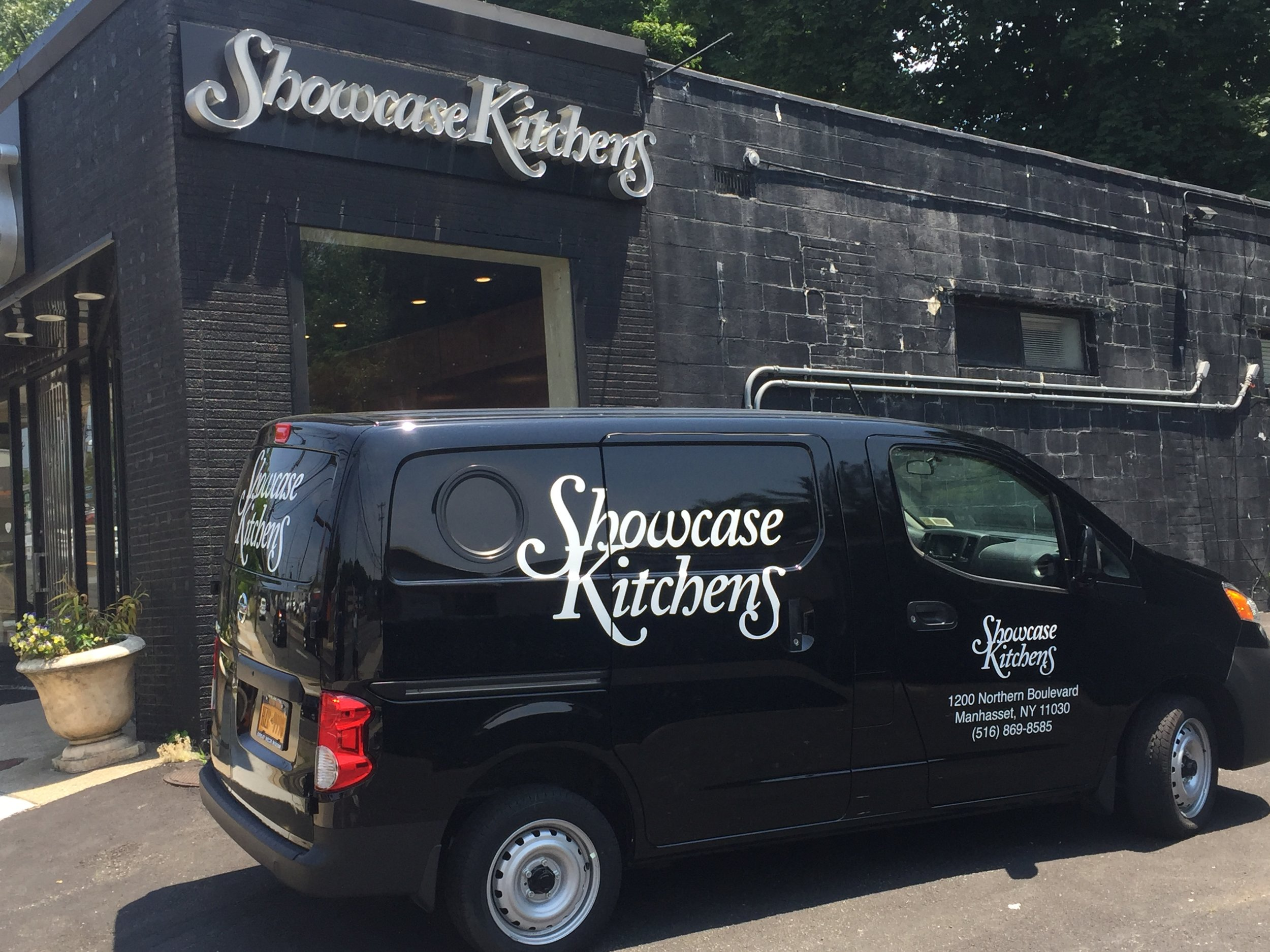 Showcase Kitchens van in front of Showcase Baths building