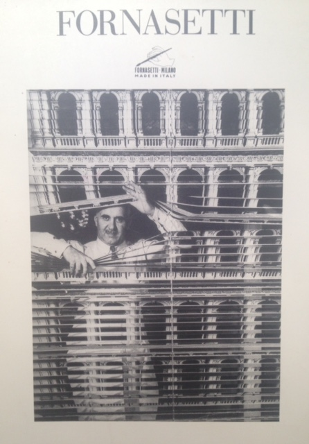 Fornasetti Piero peering from studio window with Balcony Arch Glazed Wall Tile.jpg