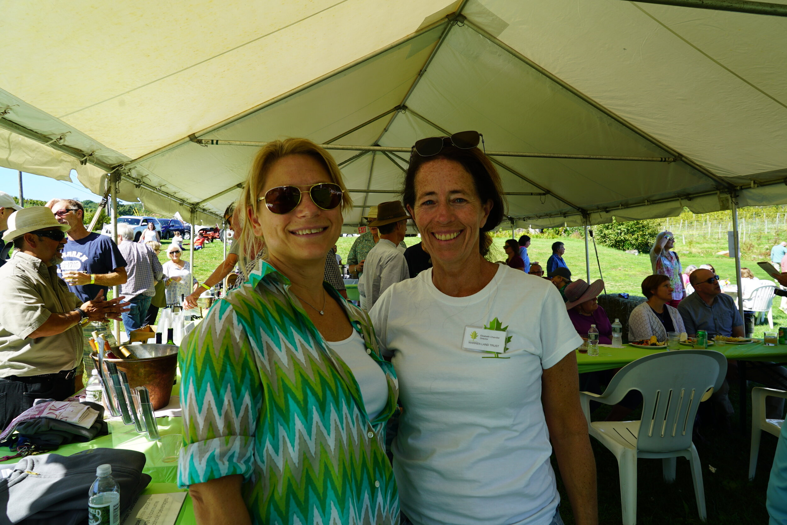 Rebecca Neary and Elizabeth Chandler are sporting WLT's colors, greens and white.JPG
