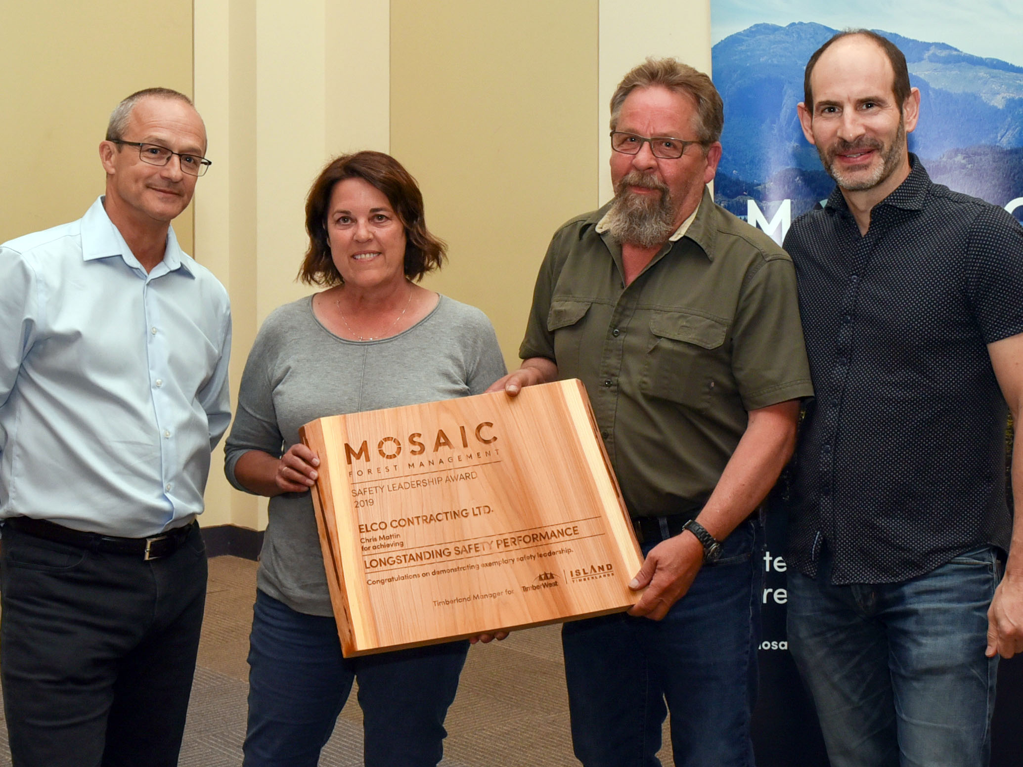 (l to r) Mosaic Forest Management's Director, Health and Safety, John Shearing; Linda and Chris Mattin, of Elco Contracting Ltd.; and Jeff Zweig, President and Chief Executive Officer, Mosaic.
