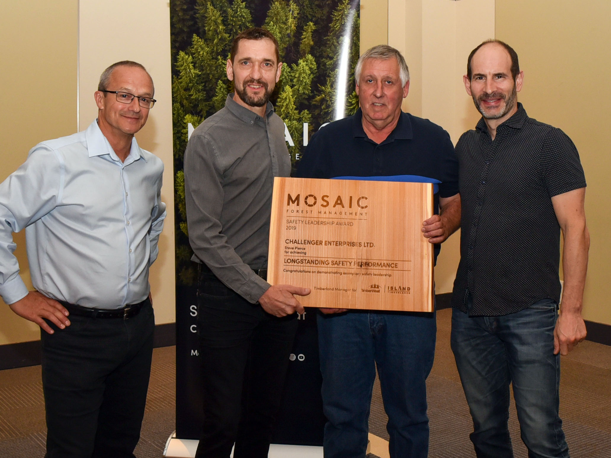 (l to r) John Shearing, Mosaic Forest Management's Director Health and Safety; James Luxmoore, Mosaic's Senior Manager, Log Purchase; award recipient, Steve Pierce, of Challenger Enterprises; and Mosaic's President and Chief Executive Officer, Jeff Zweig.