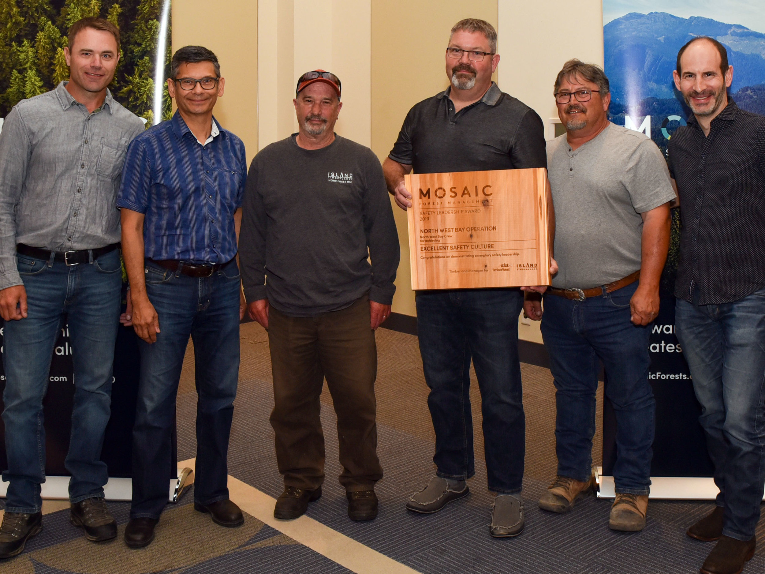 (l to r) Mosaic Forest Management's General Manager, Operations – Central Island, Kevin Ashfield; Mosaic's VP Operations, Mark Leitao; Mark Slocum, Chris Masson and Mazzio Battistuz, of North West Bay Operation; and Jeff Zweig, Mosaic's President and Chief Executive Officer.