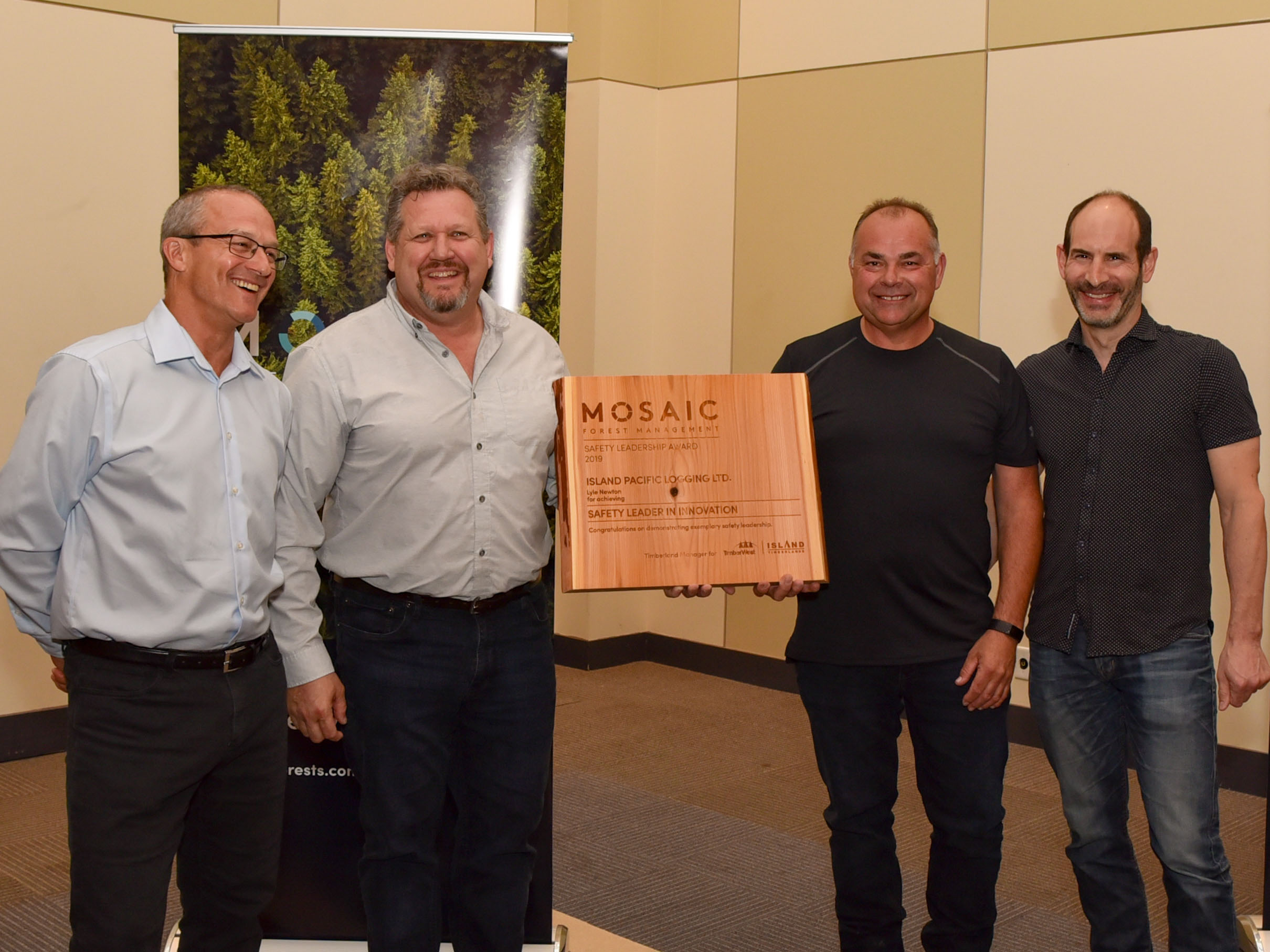(l to r) Mosaic Forest Management's Director, Health and Safety, John Shearing; Mike Reagon, General Manager, Operations – South Island, Mosaic; Lyle Newton, Island Pacific Logging; and Jeff Zweig, Mosaic's President and Chief Executive Officer.