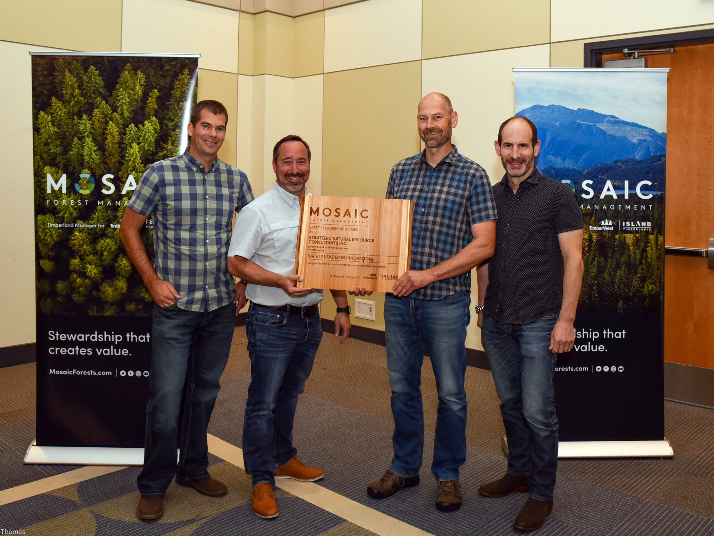 (l to r) Aaron Racher, General Manager Operations – North Island for Mosaic Forest Management; Aaron Frost and Nels Jorgenson, of Strategic Natural Resource Consultants Inc.; and Jeff Zweig, Mosaic's President and Chief Executive Officer.