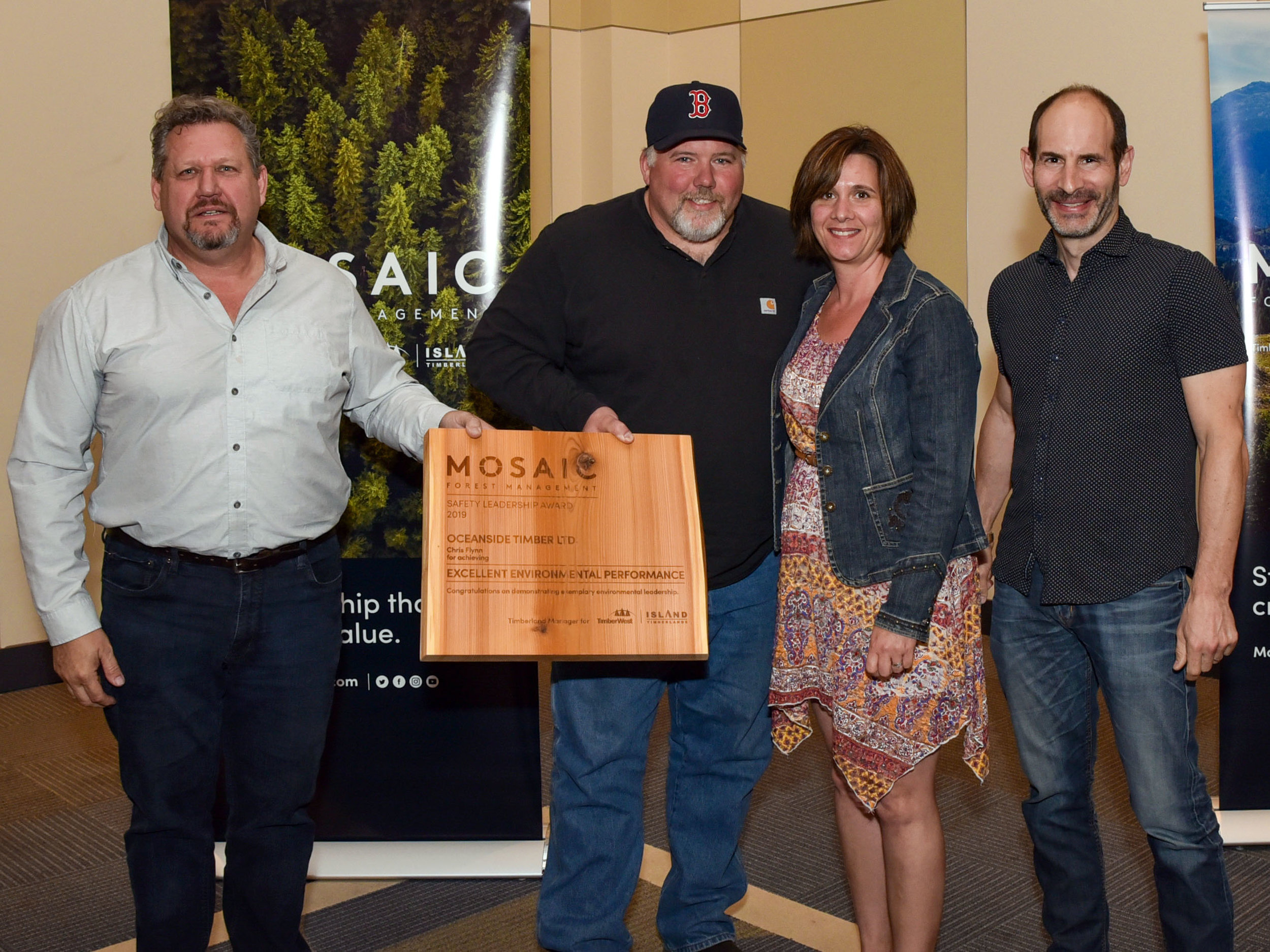 (l to r) Mike Reagon, Mosaic's General Manager, Operations – South Island; Chris and Danielle Flynn, of Oceanside Timber Ltd.; and Jeff Zweig, President and Chief Executive Officer, Mosaic.