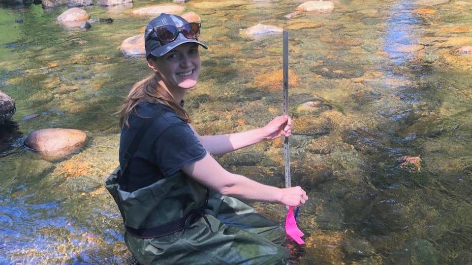 Kate O'Neill measuring vegetative cover in the Tsolum River