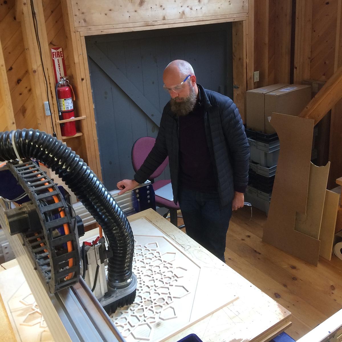 Fab lab man using CNC Machine
