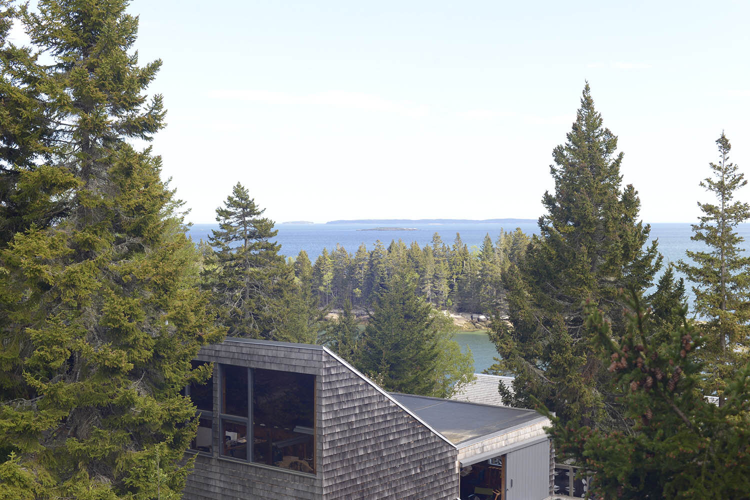 A view of the Haystack campus with the ocean in the background