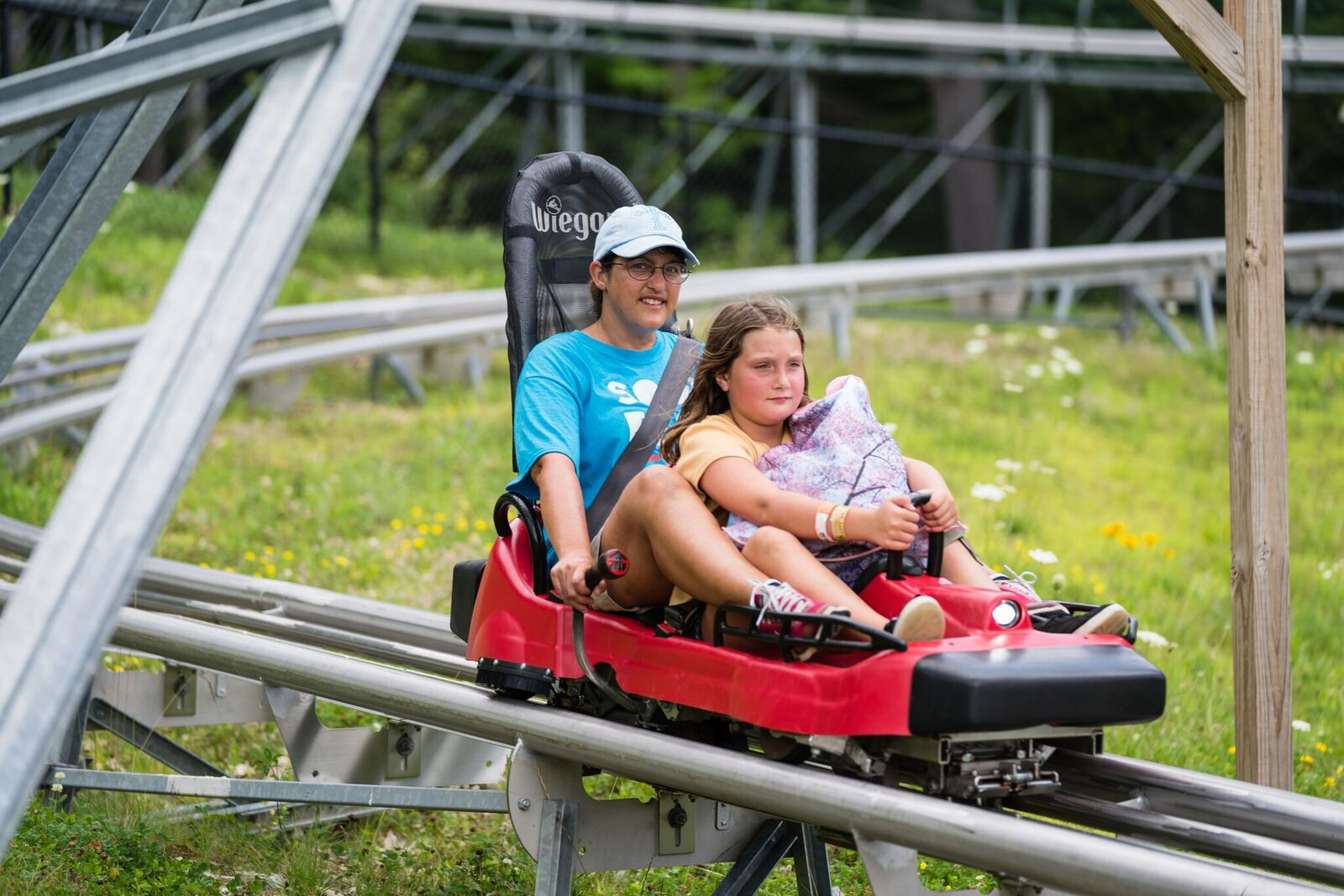 Mountain Coaster - Nearly 4100 feet long and with speeds up to 25 mph, this mountainside rollercoaster is designed with swooping turns, banked corners, rolling drops, and 360-degree turns.