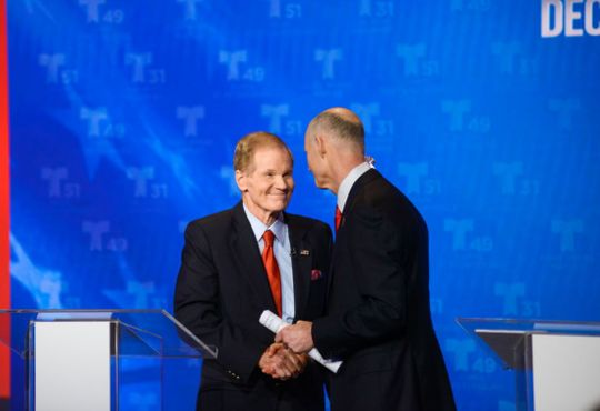 Sen. Bill Nelson and Gov. Rick Scott shake hands at the first Senate debate in Miramar, FL on Tuesday.   (Photo: Ivan Apfel for NBCUniversal/Telemundo)