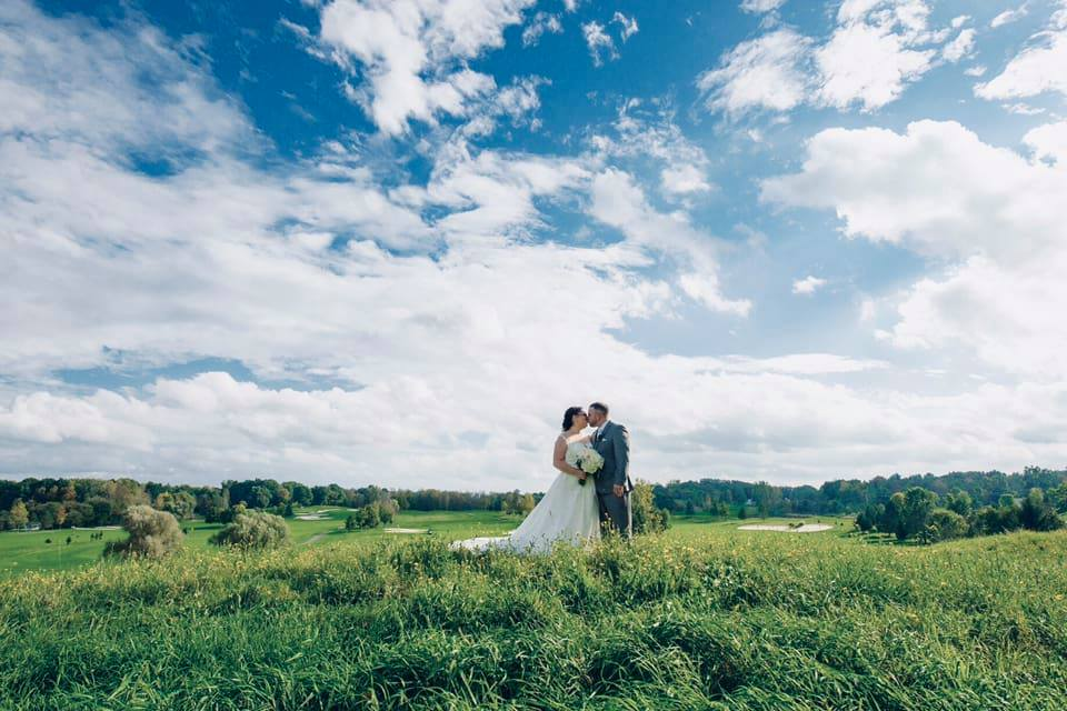 "Kelly 10/06/18 Venue: Ravenwood Golf Club Photographer:    John Larkin Photography    ""Picking out my wedding dress was such an amazing experience thanks to your awesome staff. I wasn't exactly sure what I was looking for, but I gave them some ideas and they brought me exactly what I pictured and more!"""