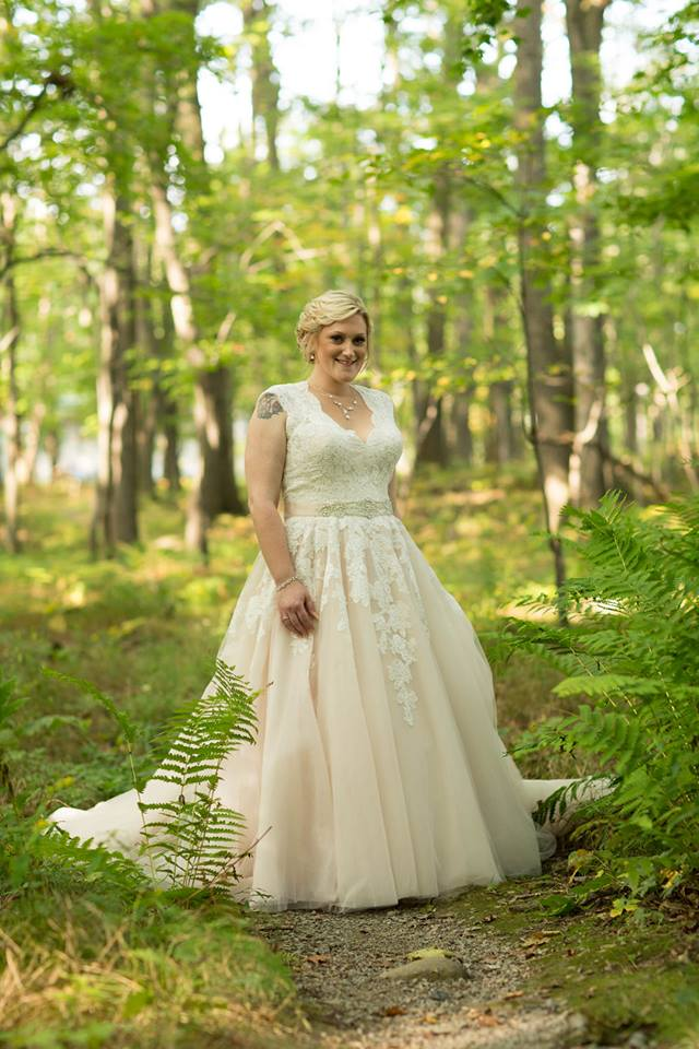 """Erika 9/15/17 Photographer:    13 One Photography    """"I got married September 15th 2017 at the Ontario County Park in Naples. My dress was my favorite part of my wedding! Picking out the dress was so much fun. I went by myself with no idea what I wanted and everyone at Heart to Heart was so helpful and honest about what dresses looked best on me. The dress I picked was Allure Bridals 9272. The alterations to the dress made it fit perfectly and it was so comfortable on my wedding day. It was truly a great experience! My photos were done by 13OnePhotography and I love looking at all the pictures of my dress. I loved my dress so much that for my year anniversary me and my husband had 13OnePhotography take anniversary photos and I wore my dress for a few of them!!! Thank you Heart to Heart for being a part of making my wedding day so beautiful and special! 💖"""""""