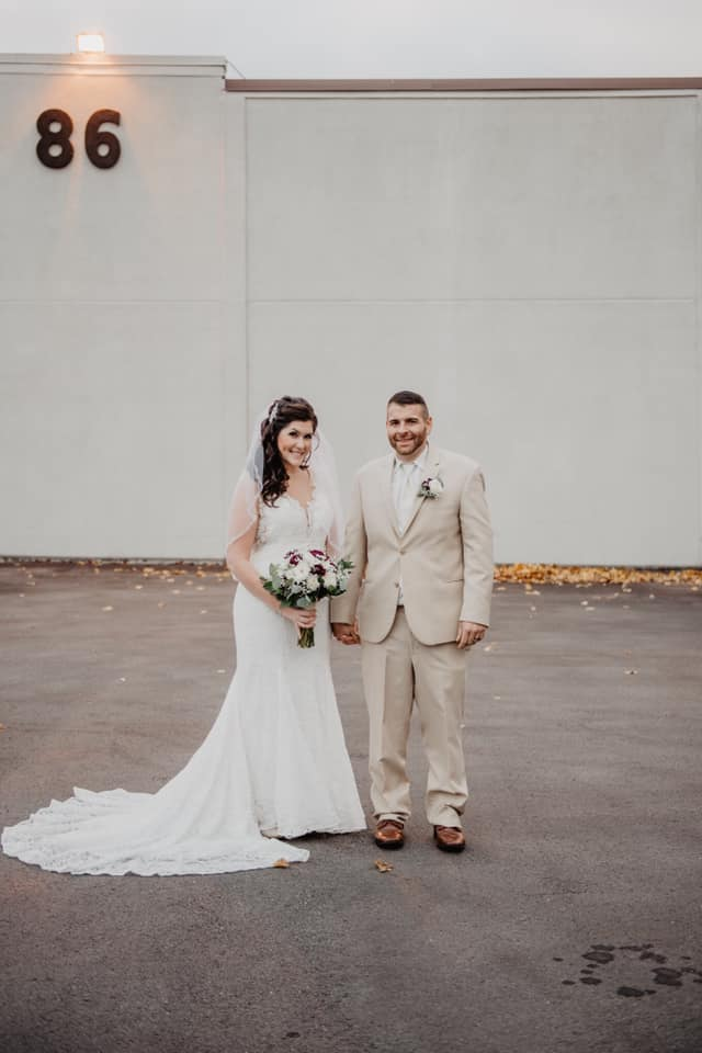 """Heidi  11/10/18 Photographer:    Emma Bauso     """"Absolutely loved my experience at Heart to Heart and have been recommending it to everyone i know that is engaged! I absolutely loved my dress and the girls were so helpful and patient with me! 😇 our wedding was at Club 86 in Geneva, NY and even though the day was a little cold and snowy it was PERFECT! i felt like royalty in my dress! Photo credit to the most amazing photographer Emma Bauso!!!! 💜"""""""