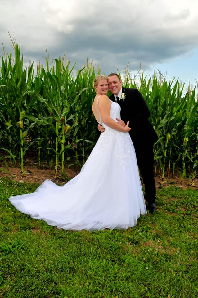 """Shannon 7/28/18 Venue: Long Acre Farms Photographer:    Party Connections    """"I got married July 28 at long acre farms and the party connections did our photography! I couldn't have asked for a better experience going through Heart to Heart Bridal. You guys made all my stress melt away with my dress even when I lost a lot of weight right before the wedding and you guys took inches off my dress a week before my wedding! I highly recommend Heart to Heart to all my engaged friends! I am so grateful that I was able to get mine and my bridesmaids dresses here! I also cannot forget how nice it was to walk in and everyone to know you by name! That was the best thing as a bride to ever feel! Thank you for making my day feel so special!"""""""