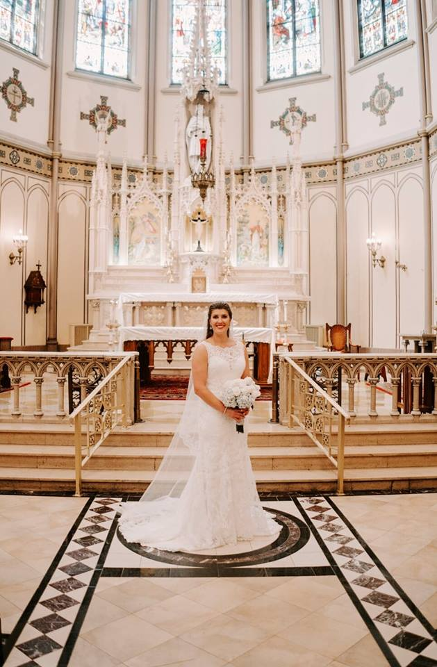 """Lindsay 8/18/18 Photographer:    Marshall Arts Studios    """"My husband John and I were married on August 18, 2018 at St Louis Church in Buffalo. We had our reception at Pearl Street Brewery. Our photographer was Marshall Arts Studios and it was very hard to pick just 1 picture for this because they did a amazing job. I only shopped at Heart to Heart Bridal for my dress. I had heard wonderful things about them and I loved my own experiences. Everyone was helpful and supportive. I would highly recommend them for bridal dresses AND alterations. They did a fabulous job. ❤️ I love my dress!"""""""