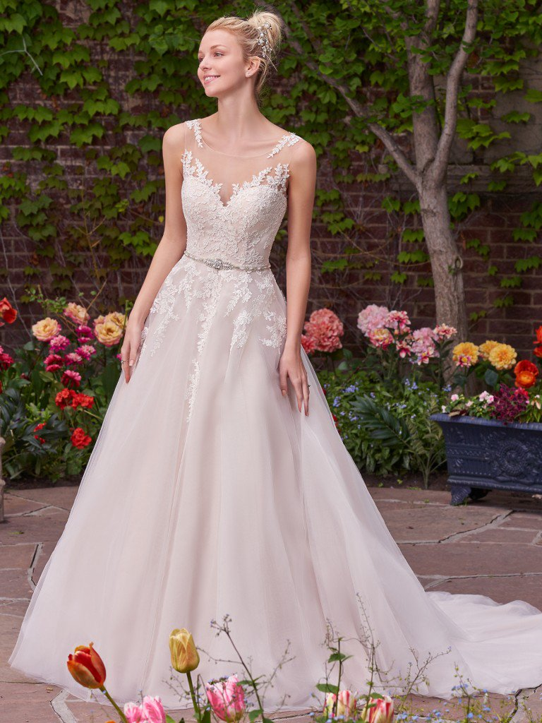 Rebecca Ingram - Rebecca Ingram is an affordable wedding gown collection featuring figure-flattering silhouettes, soft illusion, and flirty embellishments at exceptional price points. Rebecca Ingram wedding dresses range in price from $748-$1,248.