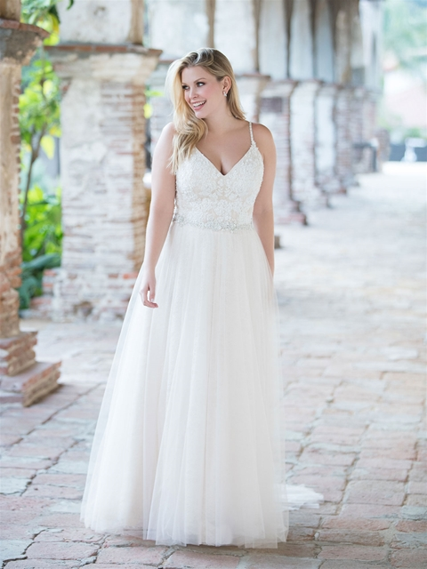 curvy brides, Sizes 16 and up - Our curvy collection features dresses ranging in price from $898-$2,198.