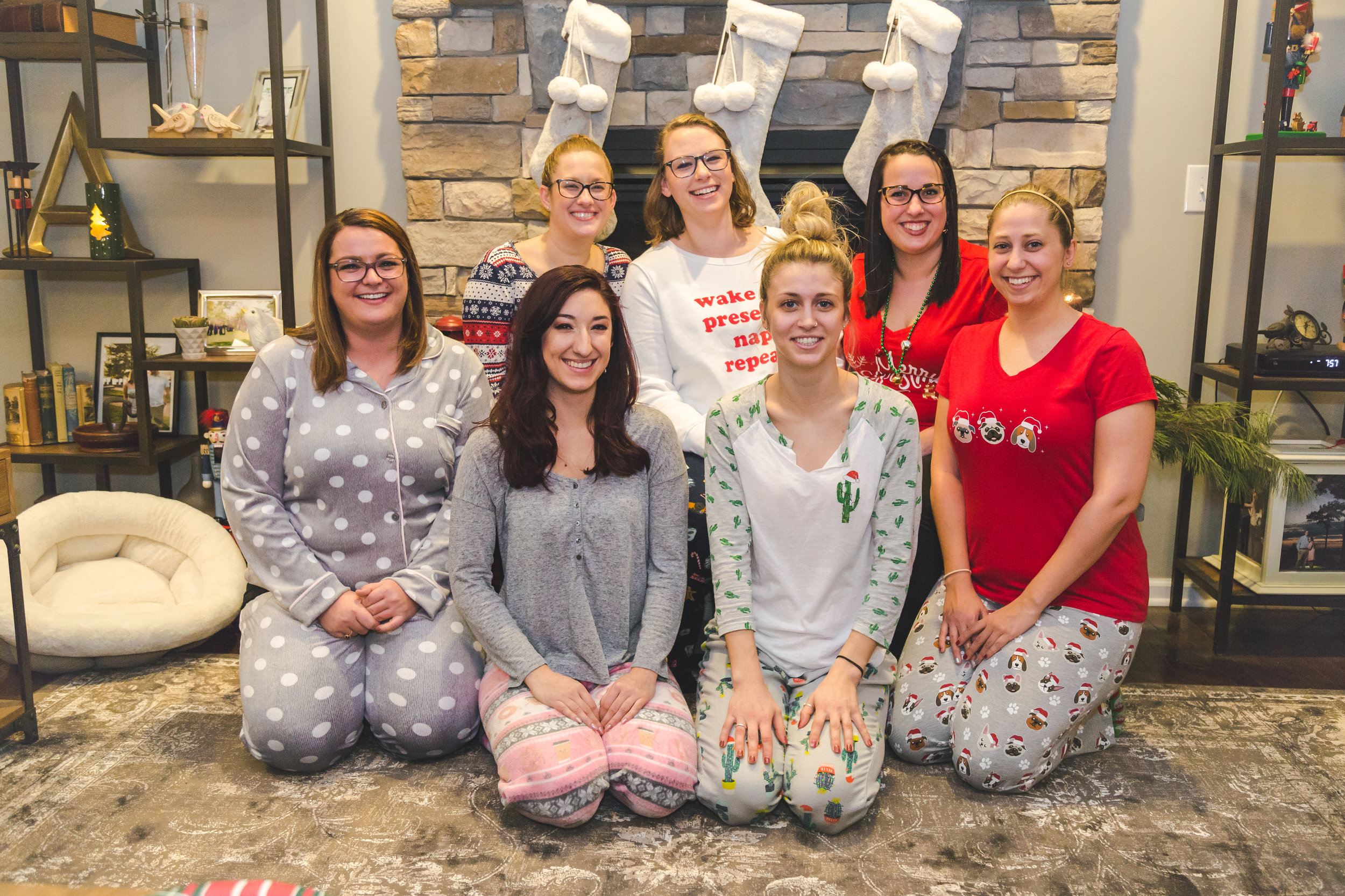 Staff Christmas Pajama Party, December 2018. From Left to Right: Top Row- Sarah, Emily M., and Jenn. Bottom Row- Courtney, Callie, Emily B., and Deanna.