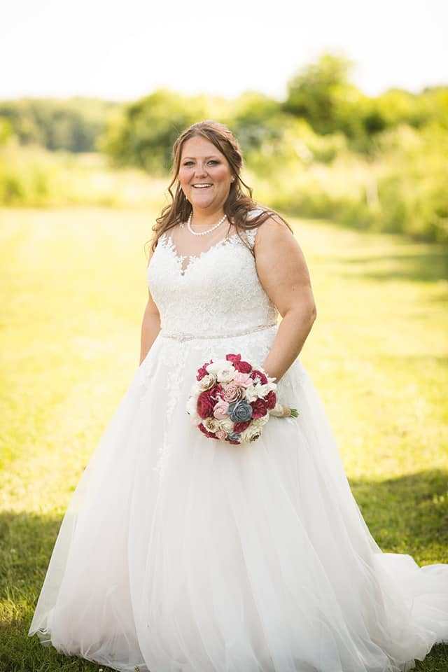 "Heather 6/16/18 Photographer:    Tim West    ""Thank you all for helping me look like a ""princess"" (my 2 year old nephew's words to me on my wedding day). Being a plus sized bride, I was nervous at first about finding a dress that would look great on me. The staff helped find one that looked flattering and without your help I would not have found a more perfect dress. Thank you for being super patient, kind, and for going above and beyond!"""