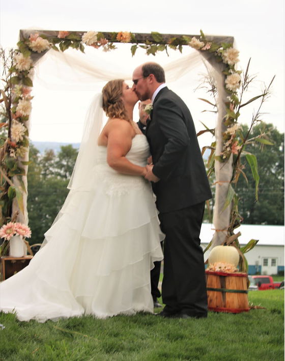 """Nicole 10/6/18 Photographer:    SoShay Photography     """"I just received half of my pictures from my wedding on October 6, 2018 at Weaver View Farms in Penn Yan, NY. My Sweetheart gown was gorgeous and I cannot thank you all enough. I had the pleasure of working with Daria before she departed. I wanted to share some of the photos with you. We had a lovely ceremony and reception. I received so many compliments and wanted to relay how I appreciated everything you have done. From the initial shopping for a dress experience, to the fittings, and now gown preservation. Everything was seamless (no pun intended)."""""""