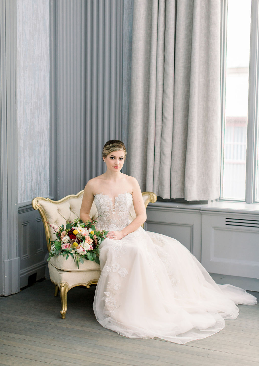 Sincerity Bridal - Sincerity Bridal embodies the graceful princess with a slight hint of edge. Sincerity is perfect for the budget conscious bride, with styles ranging in price from $898-$1,298.Photo by Chelsea Saxby PhotographyLocation: The Wilder RoomRentals: Something Borrowed RentalsShoot Coordination: Looloo's eventsModel: Sarah LaplacaFlorals: The Flower Girl
