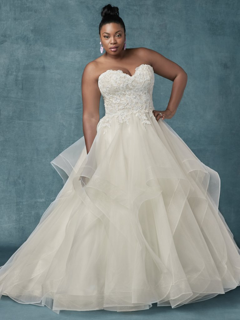 Curvy brides, sizes 16 and up - Every bride deserves to be able to try on wedding dresses that fit, which is why we stock over 100 wedding dresses in bridal sizes 16-32 every day! We have Rochester, NY's largest selection of plus size wedding dresses! Our bridal consultants are highly trained to know what cuts and dresses are best for our curvy brides. Our curvy collection features dresses ranging in price from $898-$2,698.