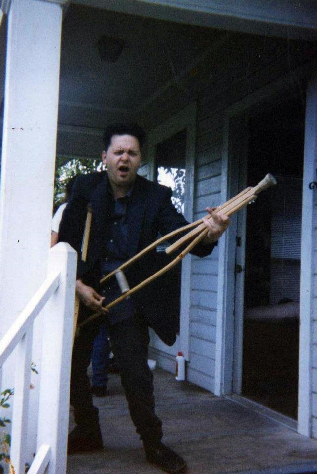 Randy as most HCN people recognize him now. Crutches don't stop him! 1996, Austin, TX