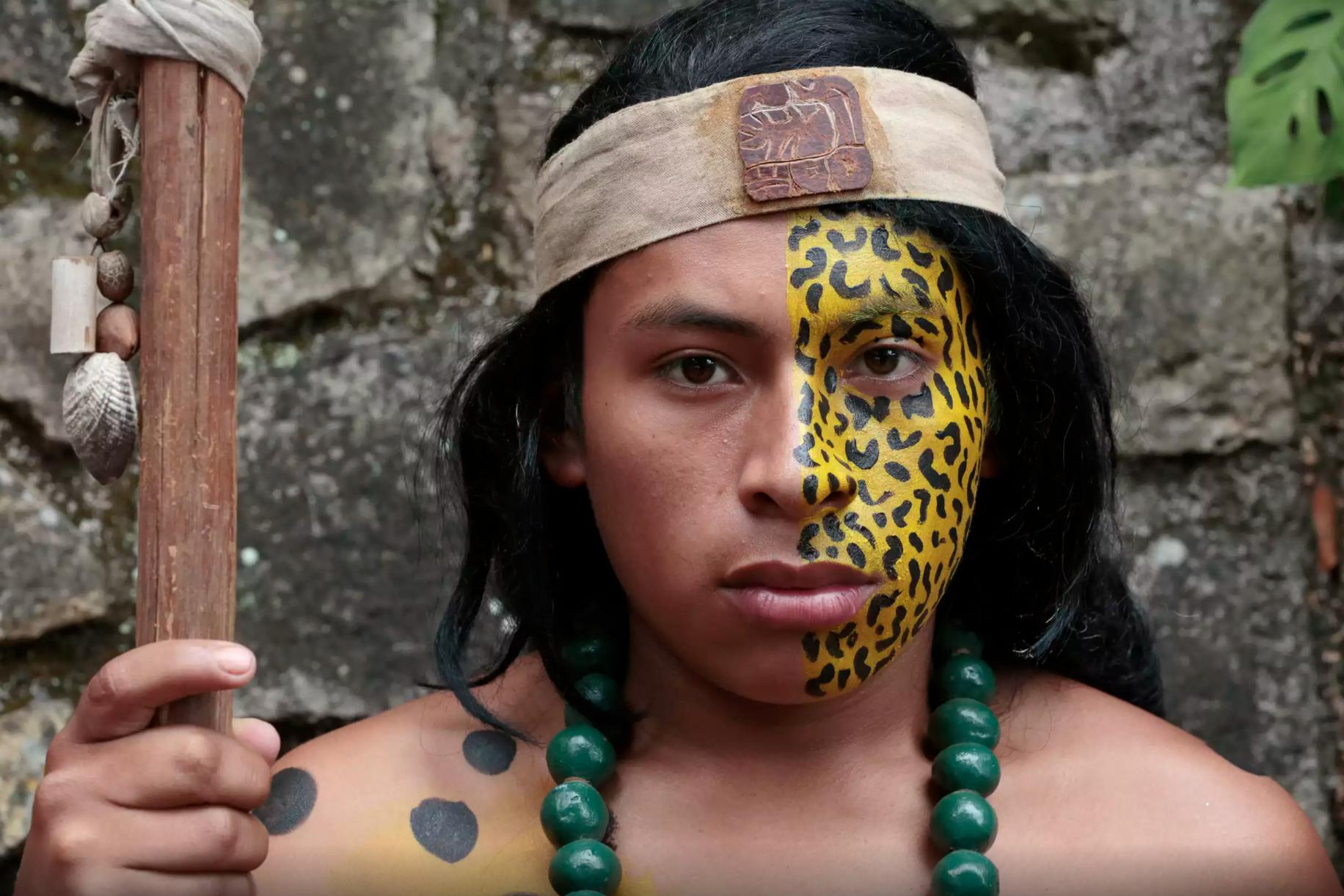 A young indigenous man in Honduras painted as a jaguar. (Photo UN)