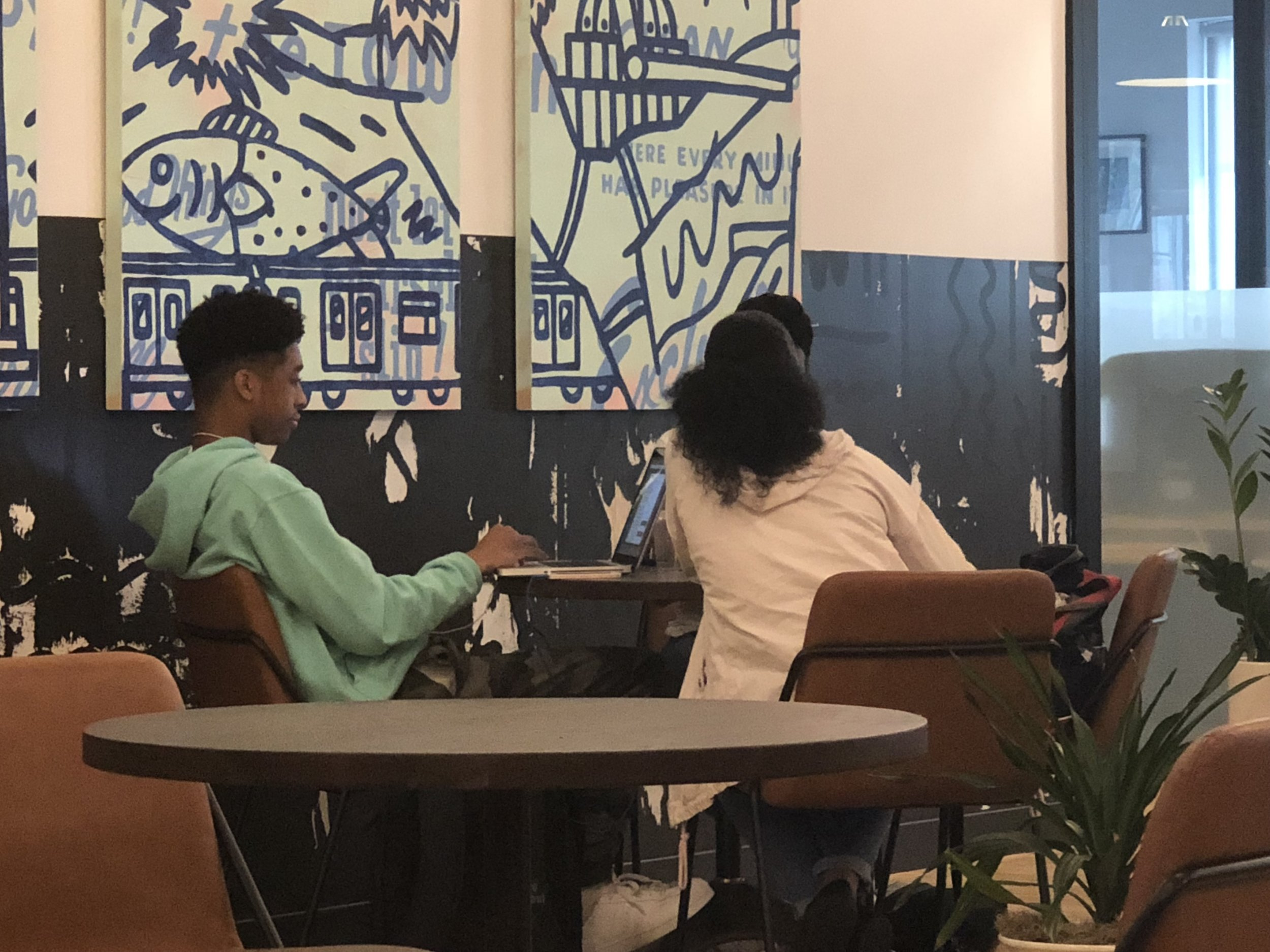 Our Youth Strategists, Brandon Alston and Kayla Boodoo building a project schedule for Technology for Children Africa in WeWork.