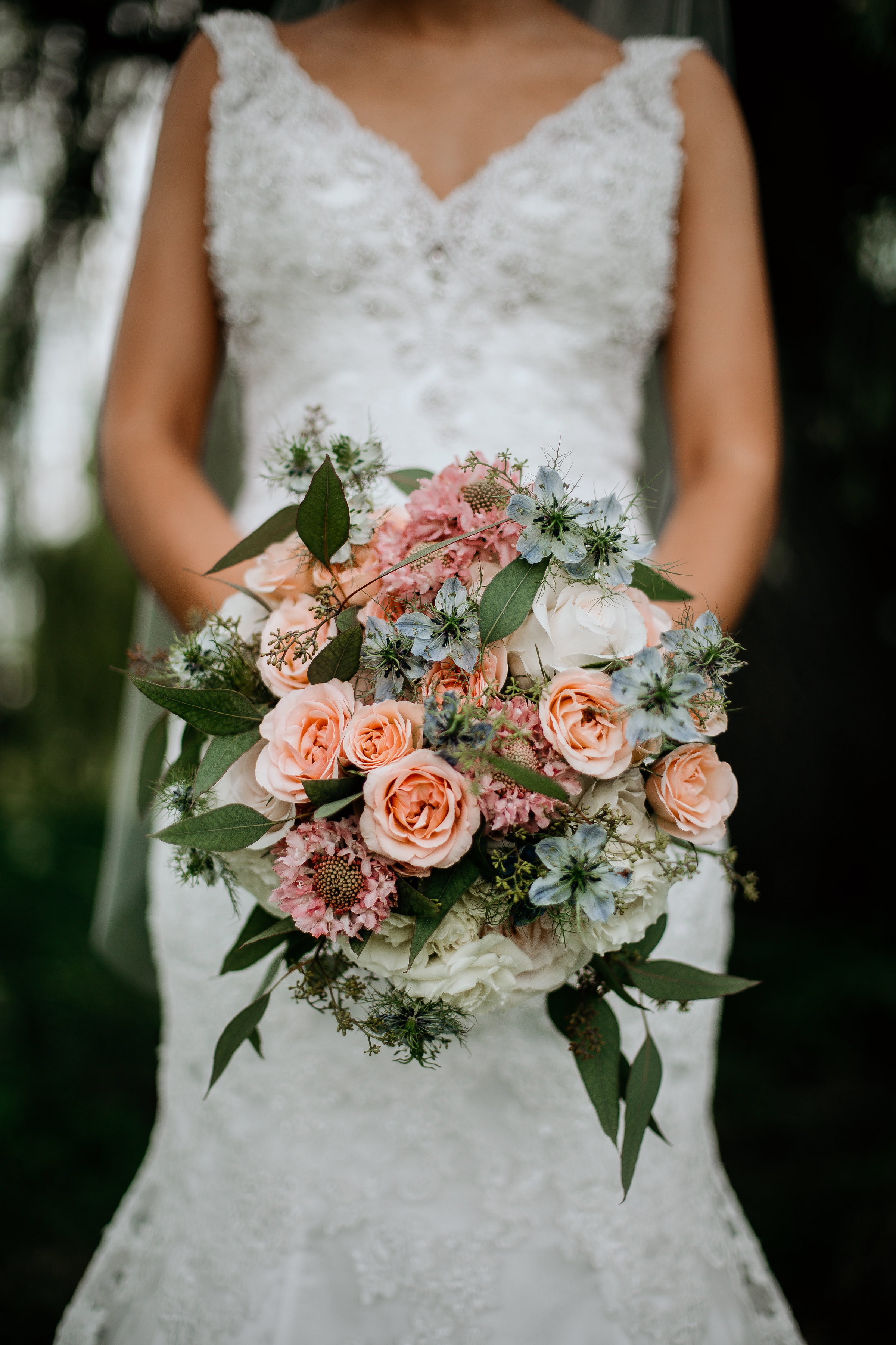Peach, pink, blue and white bridal bouquet