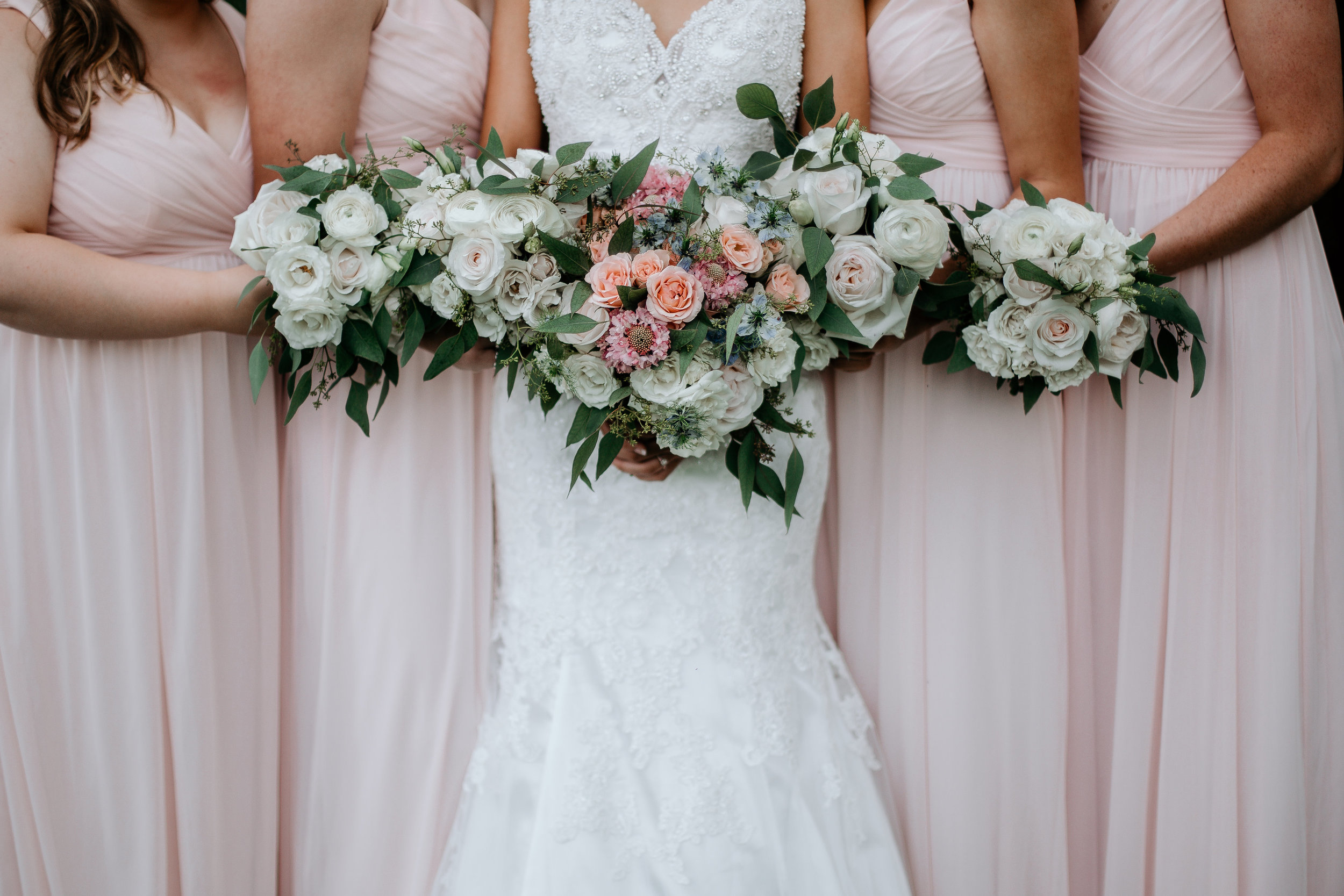 Juliet garden roses, white standard mums, spray roses and dusty miller. Credit: Tiffany Morse Photography