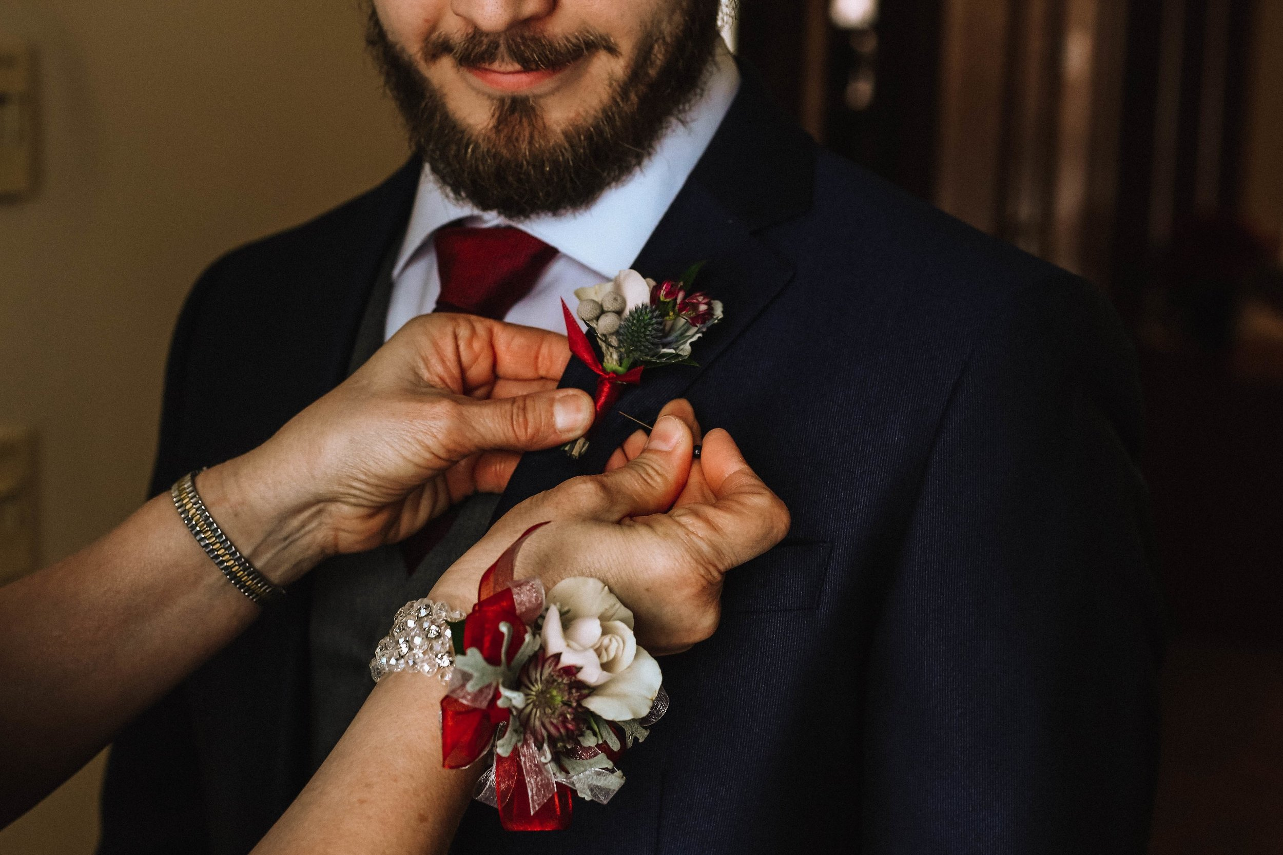 Boutonniere for groom and wrist corsage for Mom