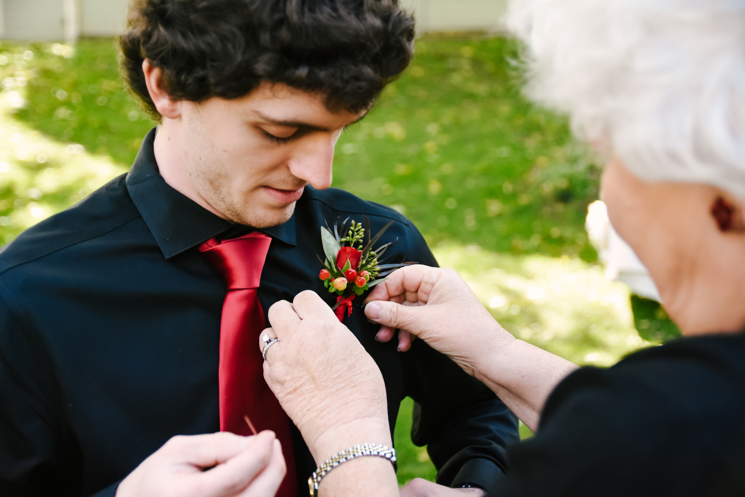 Boutonniere for black and red wedding