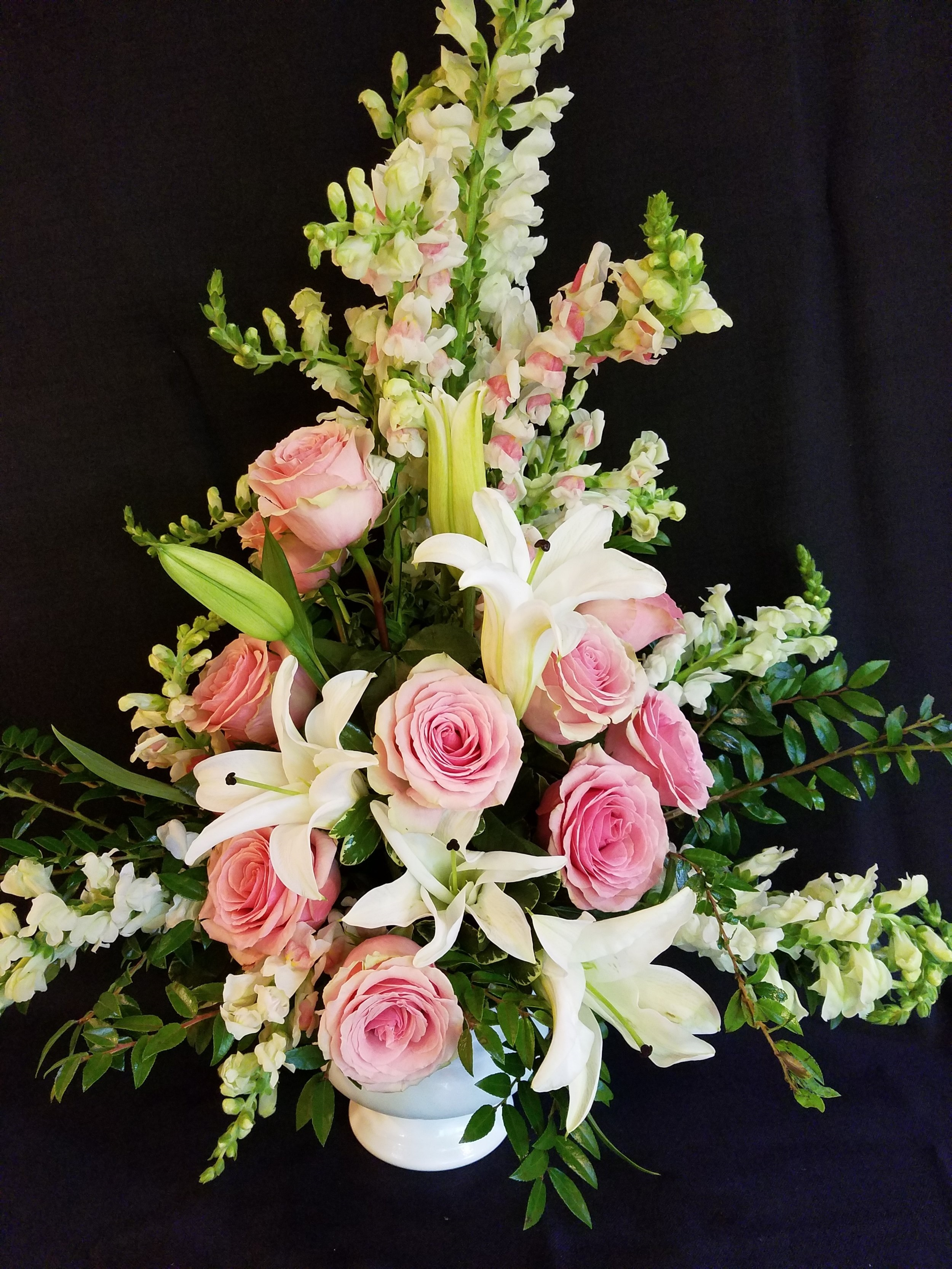 Flowers for sympathy, tribute, funerals, memorial services. Pink roses with white lilies.