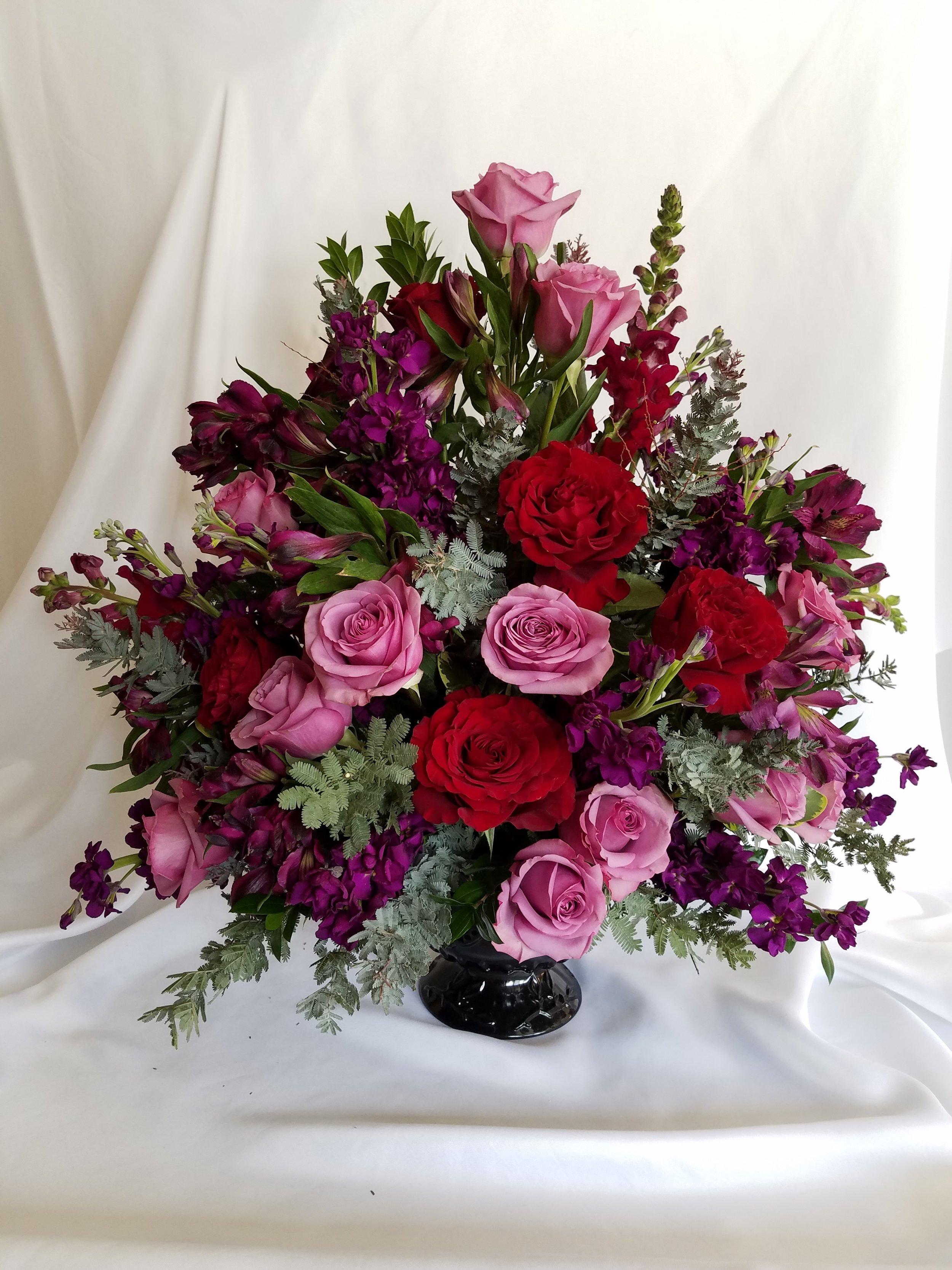 Moody red, pink purple sympathy arrangement