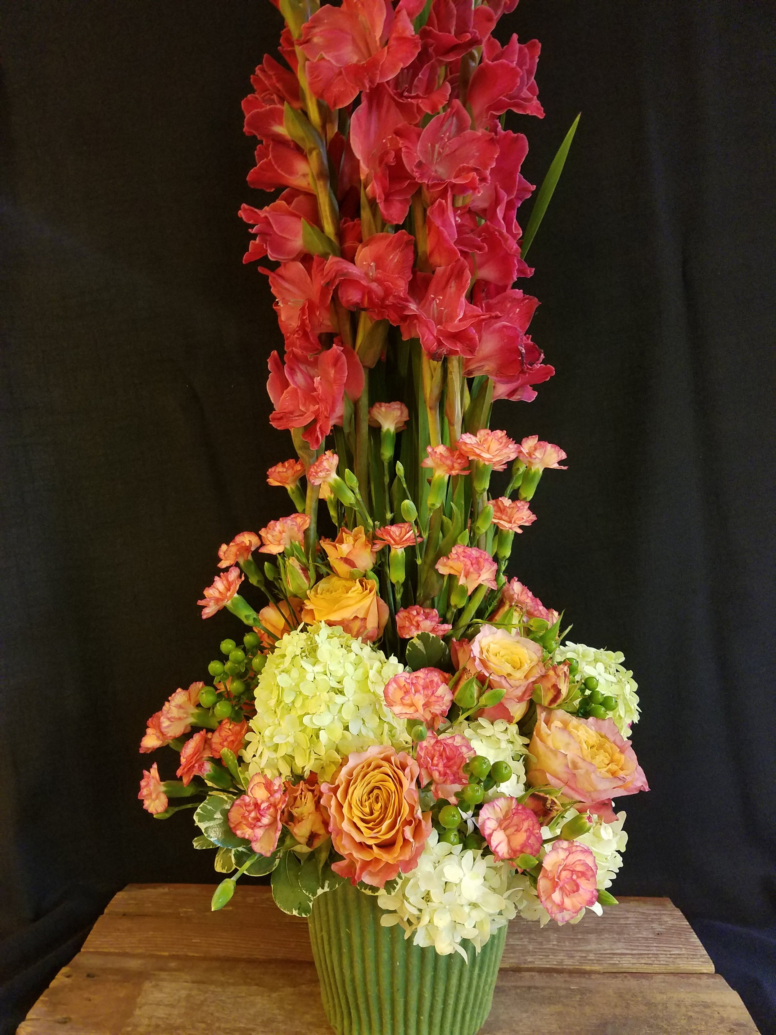Tall contemporary funeral arrangement