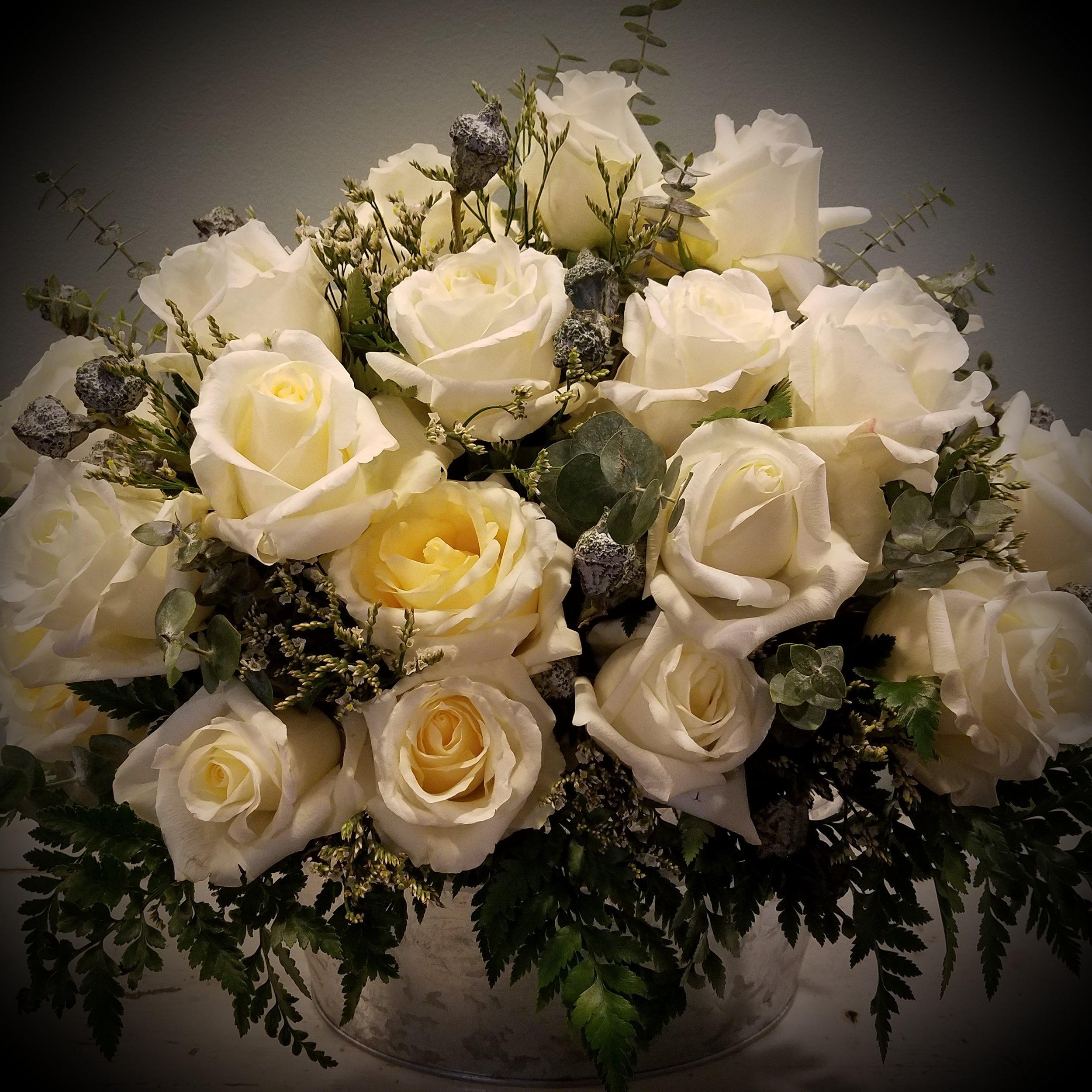 White roses sympathy arrangement