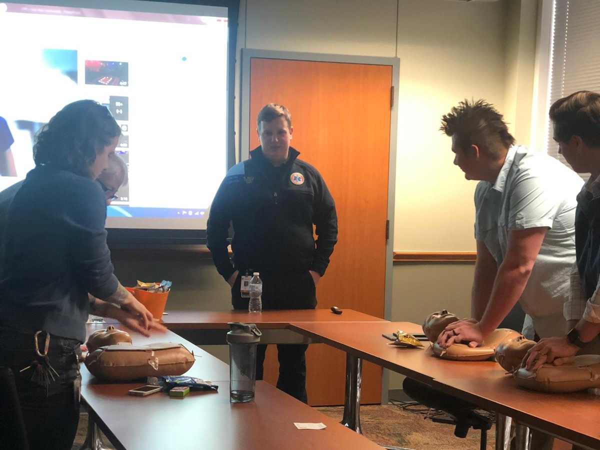 Captain Bell teaching CPR to university staff