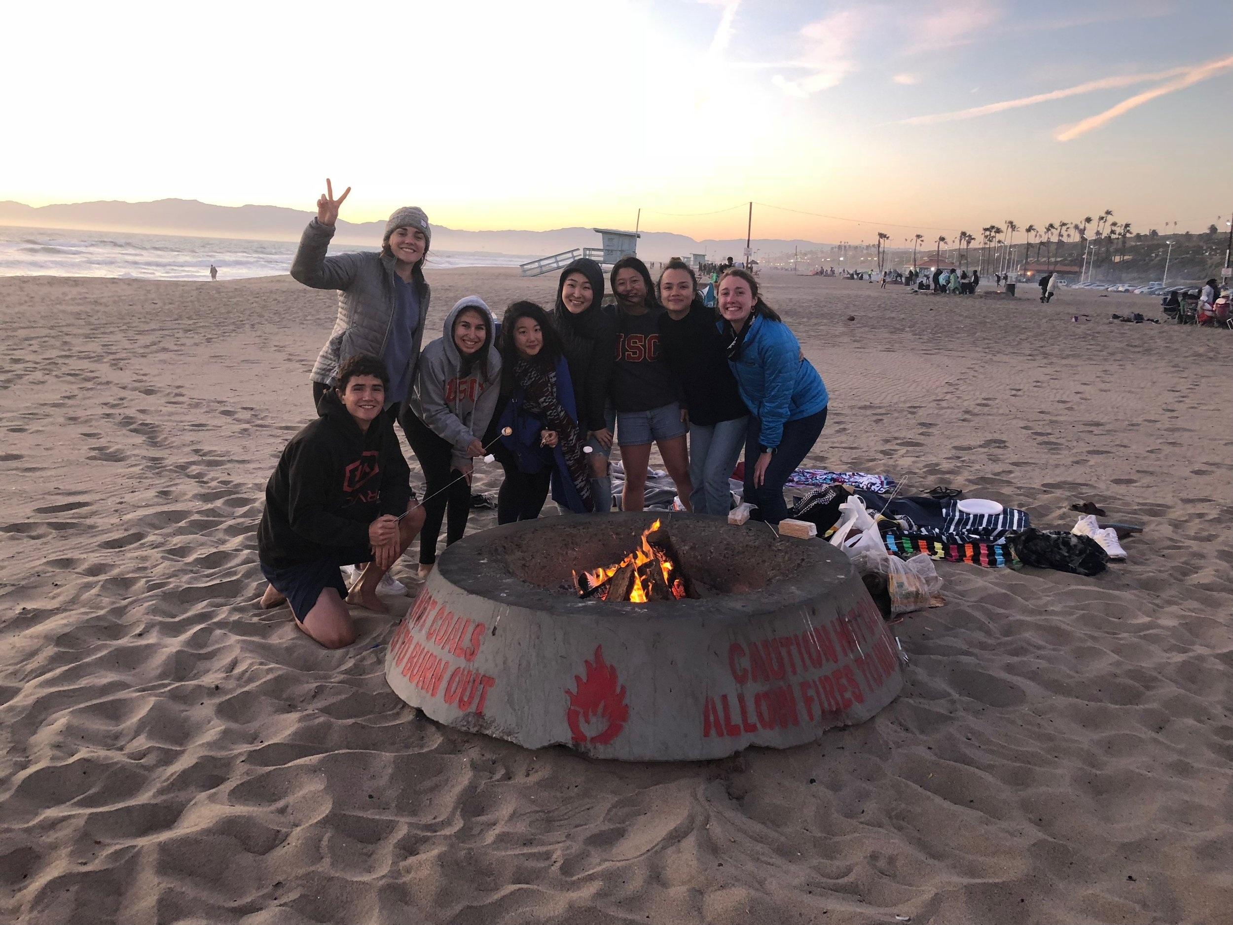 Trojan Shelter team enjoying smores at our beach bonding day.