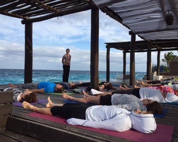 Mia leading a yoga class in Cozumel – a dream come true!
