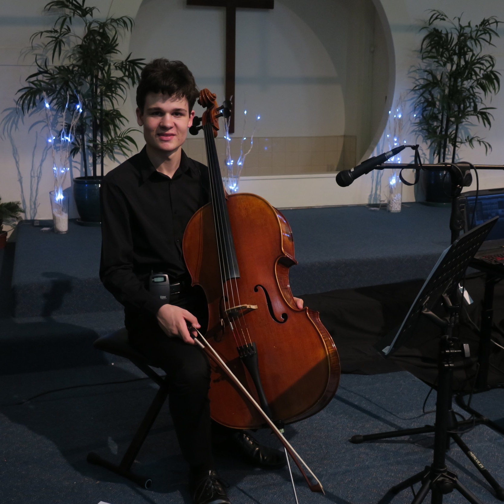 Isaac with cello at concert