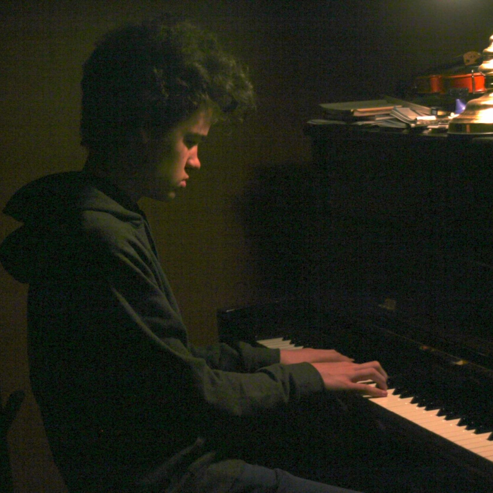 Isaac playing piano