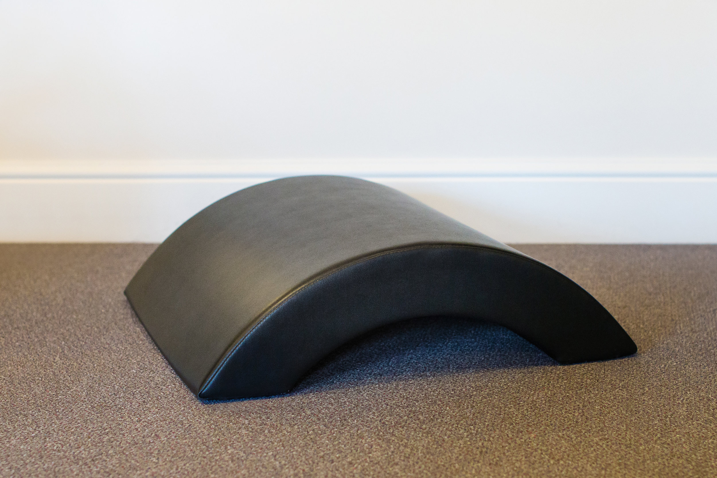 Arc Barrel - We have 3 types of barrels in the studio. The Arc Barrel, Ladder Barrel and Spine Corrector.The Arc Barrel, being the smallest features a gentle curve which helps to decompress and lengthen the spine. This can be uses to increase or decrease challenge during mathwork exercises and assist rehab clients.