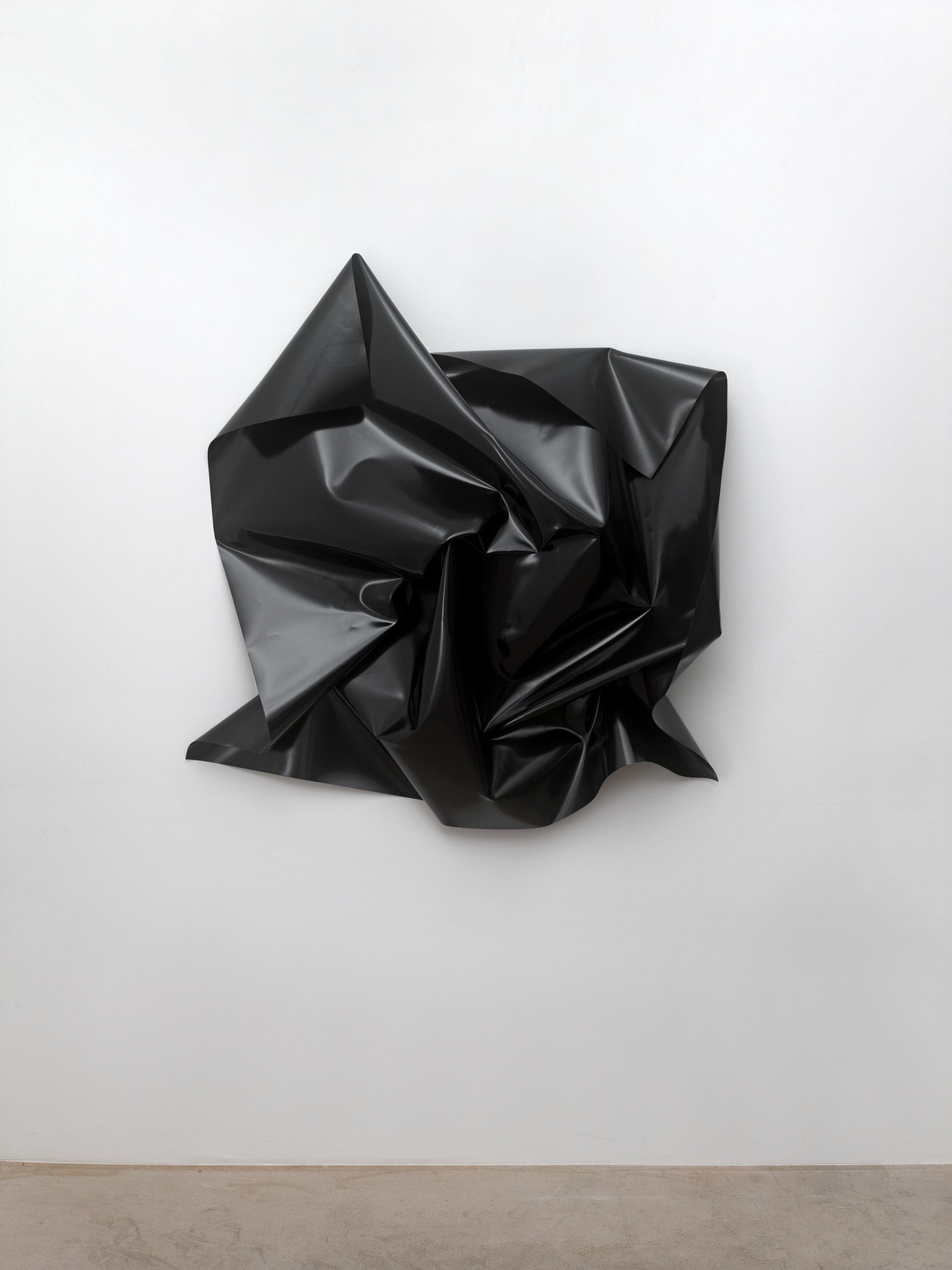 o.T., (untitled), 2013  PVC-tarpaulin (black), 4 brass screw closures, ca. 135 x 135 x 32 cm, dimensions of the tarpaulin: 150 x 150 cm