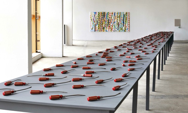 Useless, 2015  Hand cast plaster polymer (jesmonite), enamel paint, table; dims.: 20 metres, 100cms x 70cms