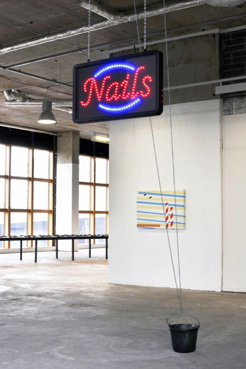 Nails, 2015  Flashing LED sign, chain, ceiling hook, bucket, nails